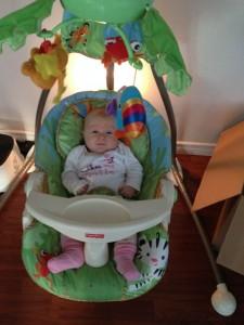 Maeva in the baby swing