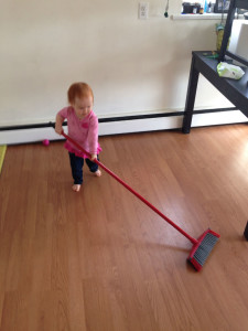 Maeva cleaning the floor!